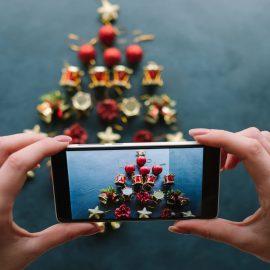New Year's blog mobile photo on dark background. social media holidays. handmade christmas tree for winter holidays